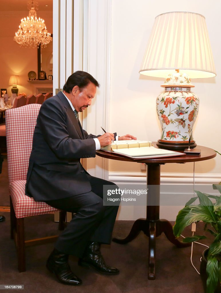 Sultan of Brunei Darussalam, His Majesty Hassanal Bolkiah signs a book recognising his visit before an official dinner at Premier House on March 27, 2013 in Wellington, New Zealand. The Sultan of Brunei is being hosted in New Zealand for an official visit over four days to strengthen ties between the two countries ahead of the Association of South East Asian Nations which is being hosted by Brunei later this year.