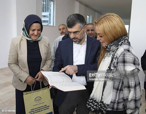 Sultanbeyli Municipality Mayor Huseyin Keskin presents the Holy Qoran as a gift to American actress Lindsay Lohan during her visit at Immigrant...