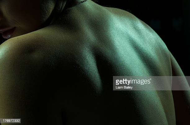 Sultry shot of woman from the side and back
