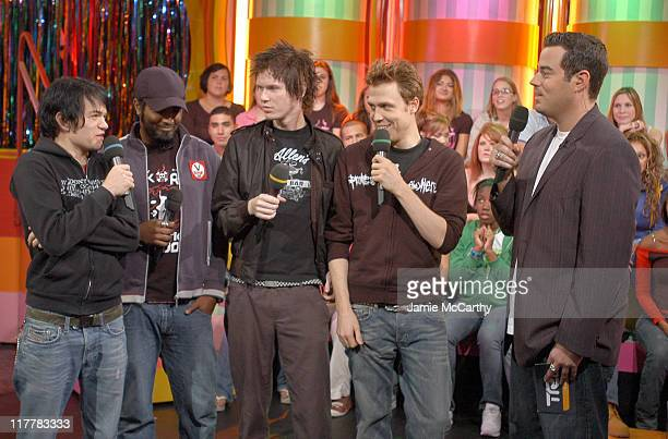 Sum 41 and Carson Daly during Sum 41 Surprises Fans by Giving Away Epiphone Guitars on MTV's 'TRL' October 14 2004 at MTV Studios Times Square in New...