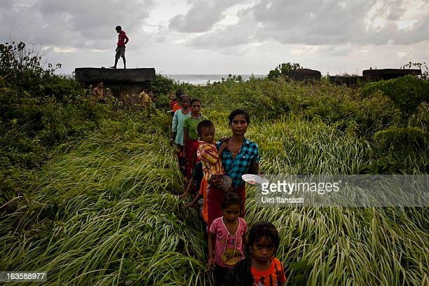 Sumbanese people perform the praying ritual to the grave of their ancestors before the pasola war festival on the next day at Wainyapu village on...