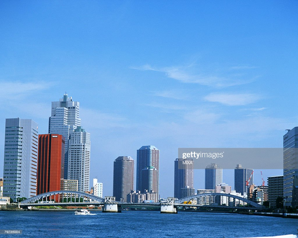 Sumida river and buildings : Stock Photo