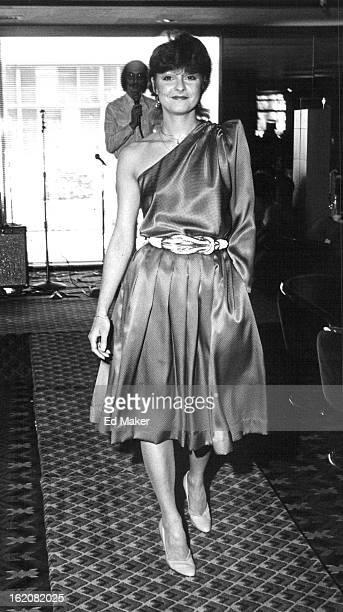 MAR 29 1982 JUL 2 1982 JUL 6 1982 Sumie Novak's oneshouldered blue silk cocktail dress is accented by gold braid belt