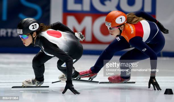 Sumire Kikuchi of Japan skates in front of Suzanne Schulting of the Netherlands during the ladies 1000m quarterfinals heat two during the Audi ISU...