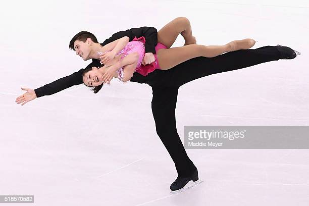 Sumire Suto and Francis Boudreau Audet of Japan skate in the Pairs Short Program during Day 5 of the ISU World Figure Skating Championships 2016 at...