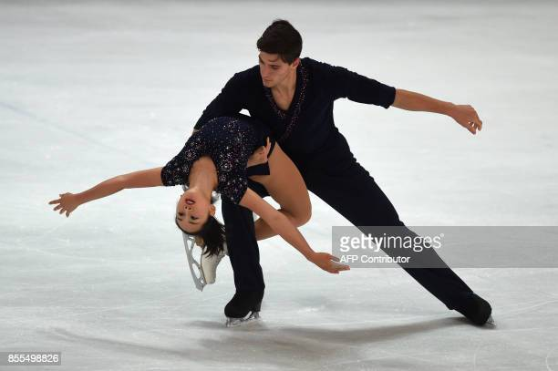 Sumire Suto and Francis BoudreauAudet from Japan perform during their pairs free skating program of the 49th Nebelhorn trophy figure skating...