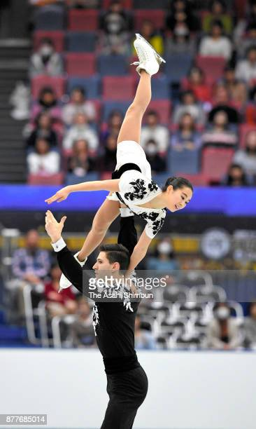 Sumire Suto and Francis BoudreauAudet of Japan compete in the Pair Short Program during day one of the ISU Grand Prix of Figure Skating NHK Trophy at...