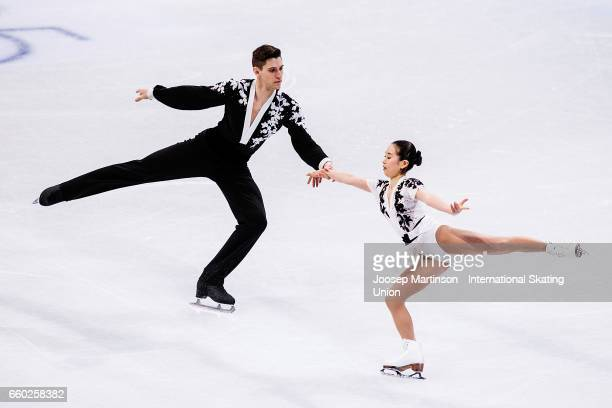 Sumire Suto and Francis BoudreauAudet of Japan compete in the Pairs Short Program during day one of the World Figure Skating Championships at...