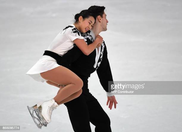 Sumire Suto and Francis BoudreauAudet of Japan perform during their pairs short program of the 49th Nebelhorn trophy figure skating competition in...
