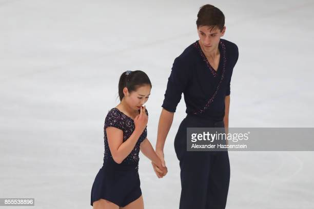 Sumire Suto and Francis BoudreauAudet of Japan racts after performing at the Pairs free skating during the 49 Nebelhorn Trophy 2017 at Eishalle...