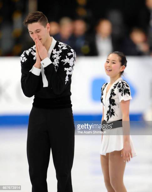 Sumire Suto and Francis BoudreauAudet of Japan react after competing in the Pair Short Program during day one of the World Figure Skating...
