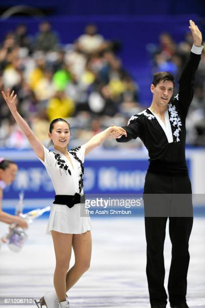 Sumire Suto and Francis BoudreauAudet of Japan react after competing in the Pairs short program during day two of the ISU World Team Trophy at Yoyogi...