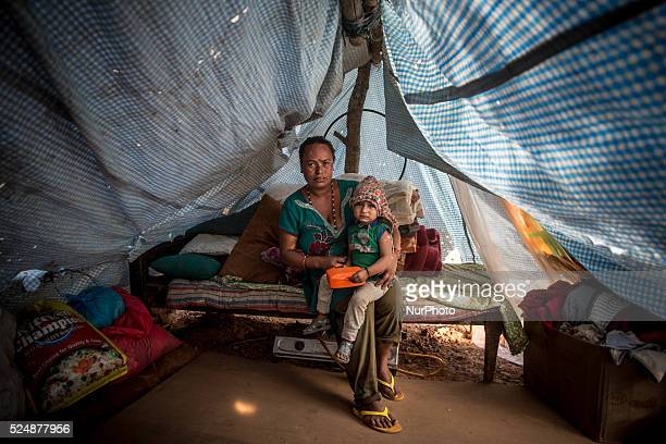 Sumit Roy Achami has taken shelter with her child in a tent Dhading Nepal May 5 2015