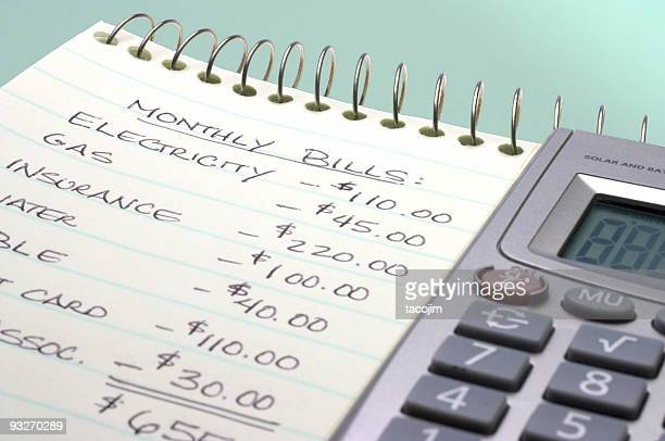 Summation of monthly bills on a notepad by a calculator