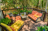 Relaxing back deck with flowers in the summertime