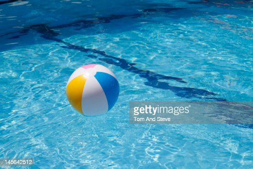 Pool Water With Beach Ball beach ball floating in swimming pool stock photo | getty images