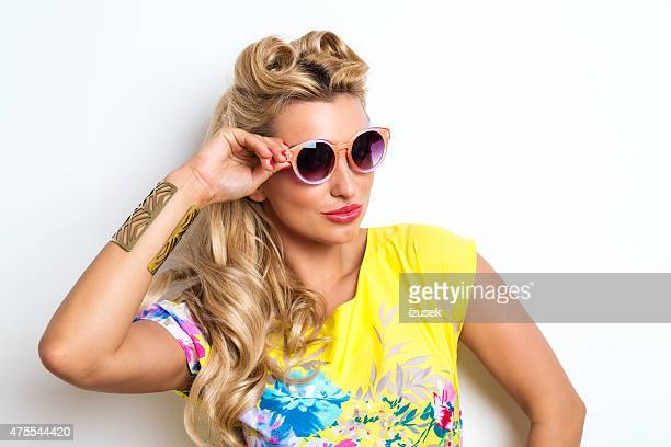 Summer Blonde Woman wearing yellow dress and sunglasses