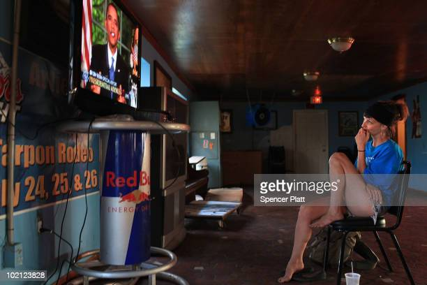 Summer Burkes of New Orleans watches in the oil stricken community of Grand Isle as President Barack Obama discusses the oil spill in the Gulf of...