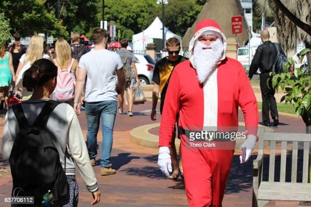 Summer Christmas - Man dressed as Santa in Summer Sun