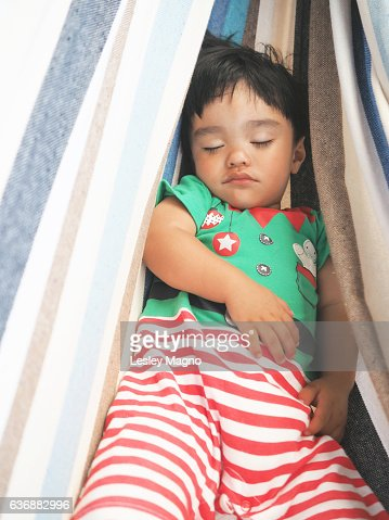 Summer Christmas - Toddler is sleeping inside the hammock