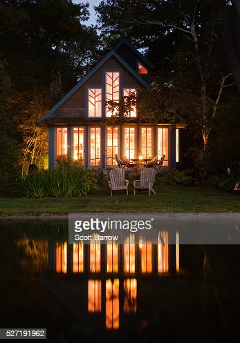Summer cottage beside a lake at night : Stock Photo