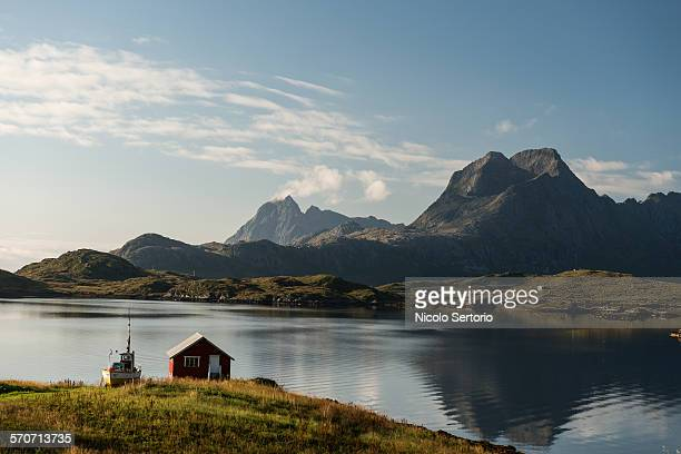 Summer cottage by fjord in summer