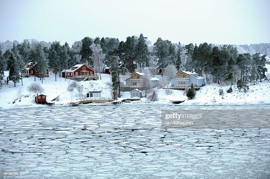 Summer cottages of Stockholm Archipelago are seen on 15 January 2010 During the winter ferries continue sailing in the Baltic Sea partly frozen...