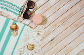 Summer Fashion girl clothes set. collection for the beach on wooden background, copy spaceSummer Fashion girl clothes set. collection for the beach on wooden background, copy space