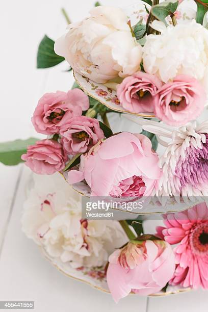 Summer flowers arranged on cake stand