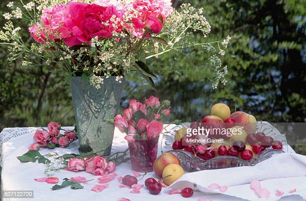 Summer Fruit With a Bouquet of Flowers
