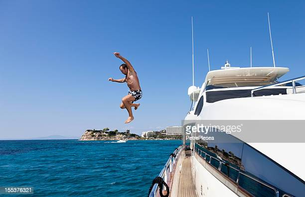 Summer Fun. Jumping from the Yacht into Ocean.