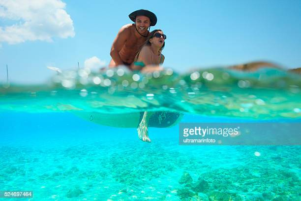 Summer fun  Romantic couple rowing dinghy  boat   Turquoise sea lagoon