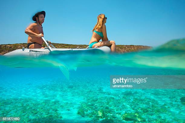 Summer fun  Romantic couple rowing dinghy  boat   Turquoise sea lagoon