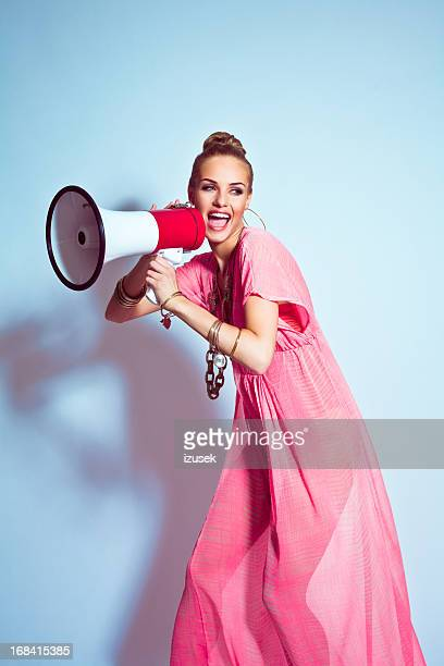 Summer Girl shouting into megaphone