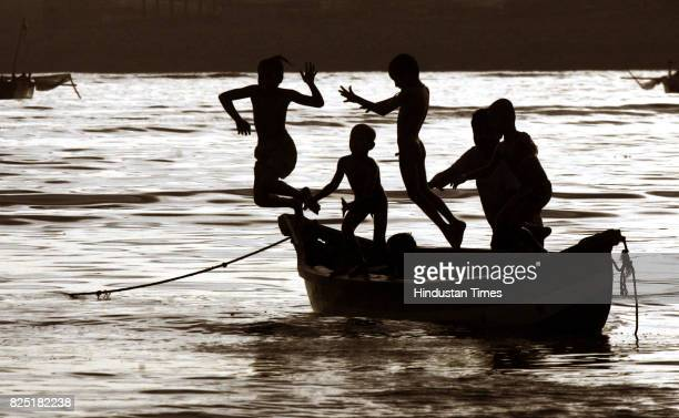 Summer Heat Boating Children leap off a boat moored in the water near the Mahim Causeway on warm tuesday evening The weather bureau has predicted a...