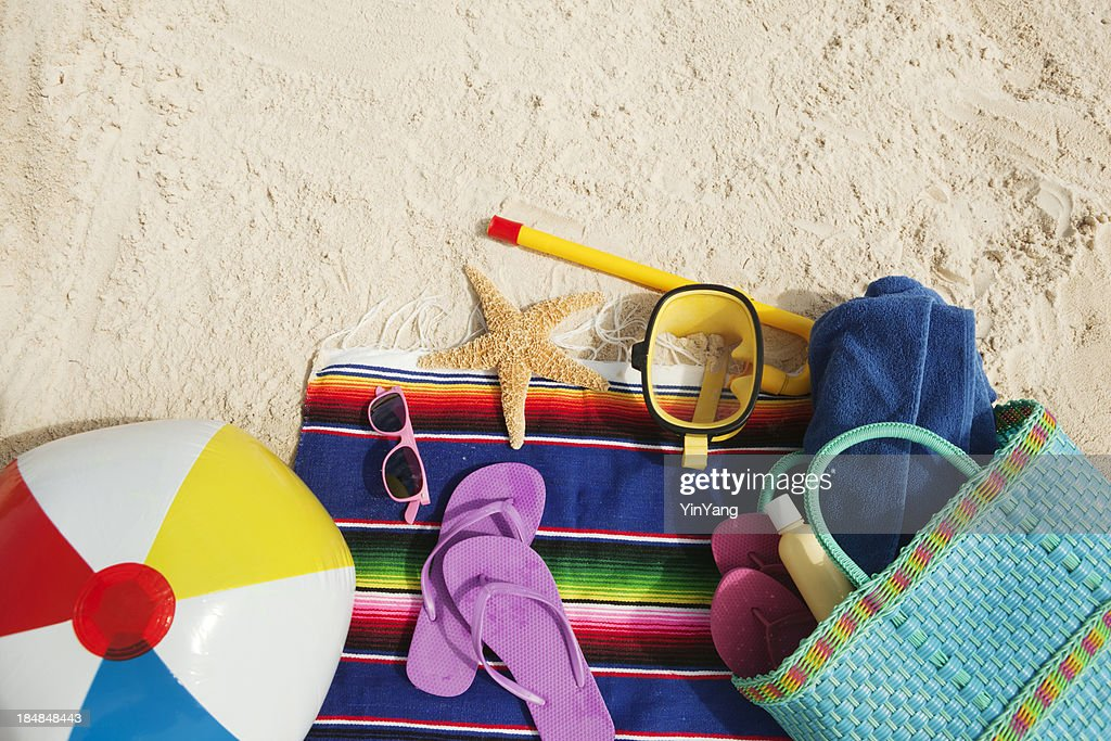 Tropical Gear and Necessities on Sandy Beach Hz