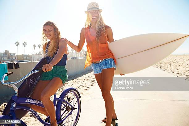 Summer life with a surfboard and bicycle