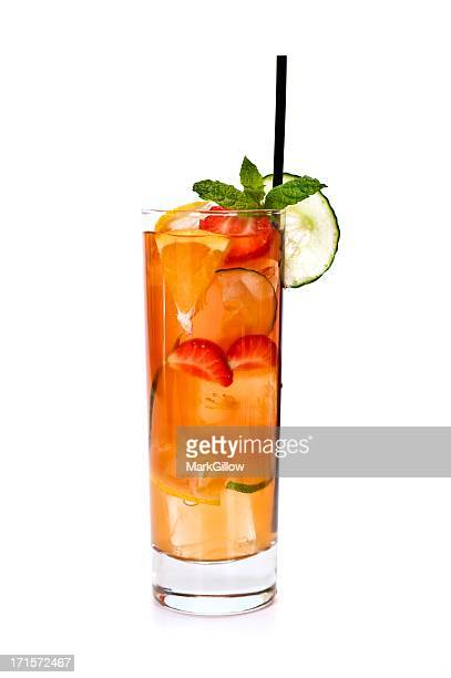 A summer mojito cocktail of strawberries orange and mint