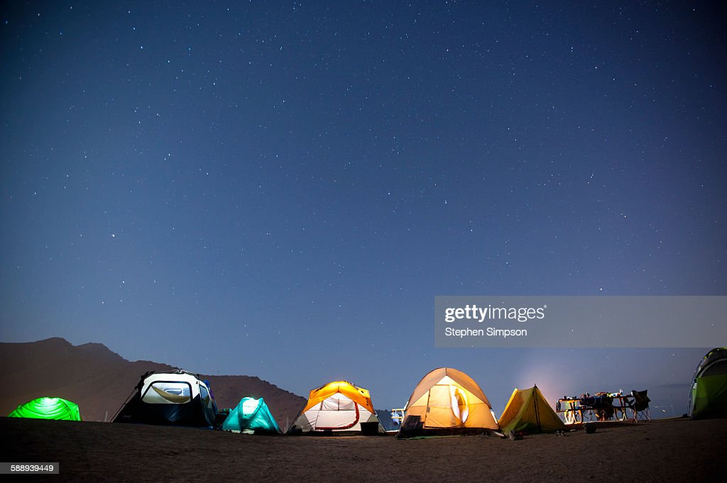 Summer night at beach side campsite : Stock Photo