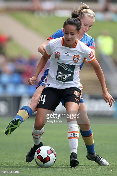 Summer O'Brien of the Roar and Grace Macintyre of the Jets contest the ball during the round 12 WLeague match between the Newcastle Jets and the...