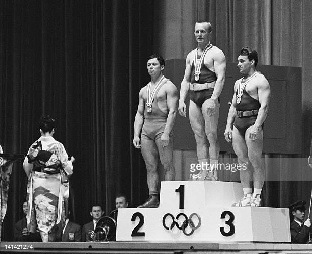 Weightlifting Poland's Marian Zielinski Soviet Union's Vladimir Kaplunov and Poland's Waldemar Baszanowski during the 1964 Summer Olympic Games...