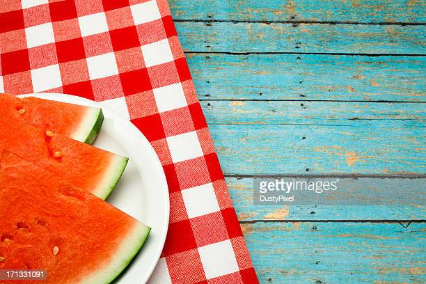 Summer picnic concept with watermelon and checkered napkin
