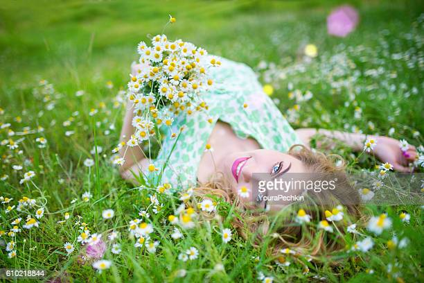 Summer portrait of a girl in the grass