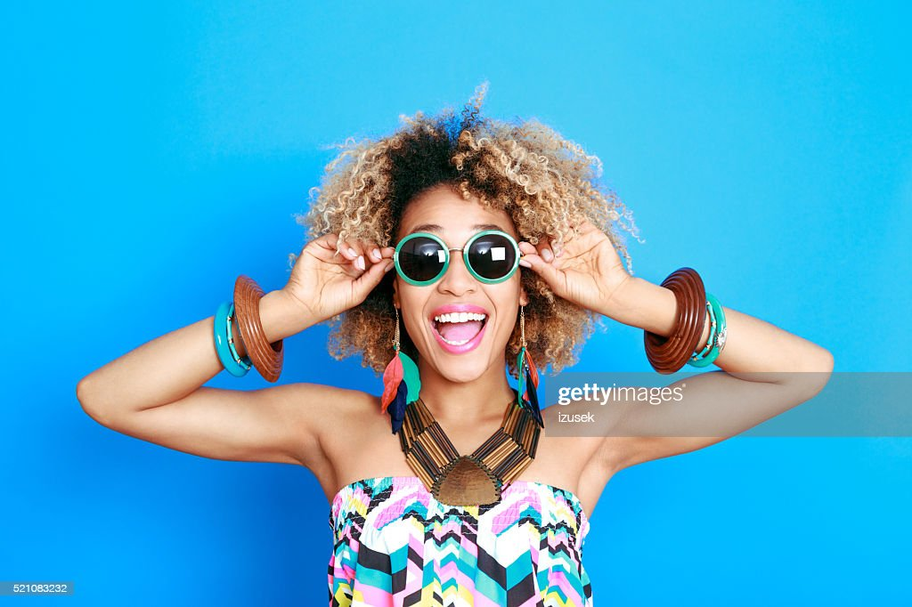 Summer portrait of excited afro american young woman : Stock Photo