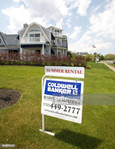 A summer rental sign sits on a front lawn of a property in Spring Lake New Jersey US on Sunday June 1 2008 New Jersey's beaches may be among the few...
