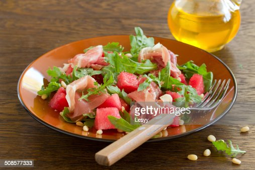 Summer salad with water-melon and prosciutto. : Stockfoto