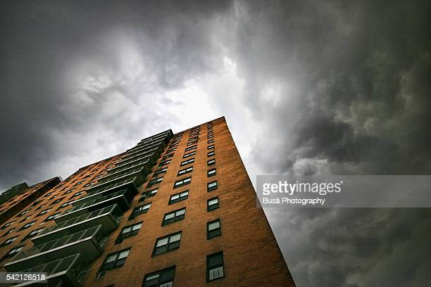 Summer storm and perspective of a public housing complex in Harlem, New York City