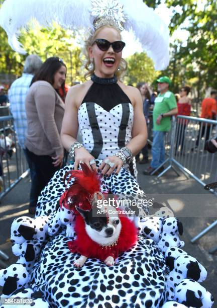 Summer Strand and her dog April Moon in costume during the 27th Annual Tompkins Square Halloween Dog Parade in Tompkins Square Park in New York...