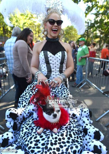 Summer Strand and her dog April Moon pose during the 27th Annual Tompkins Square Halloween Dog Parade in Tompkins Square Park in New York on October...
