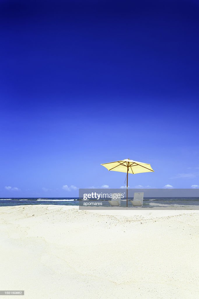 Summer tropical white sand beach with umbrella and chairs : Stock Photo